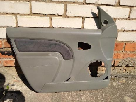 Обшивка двери передней левой Renault Logan 1 8200576876